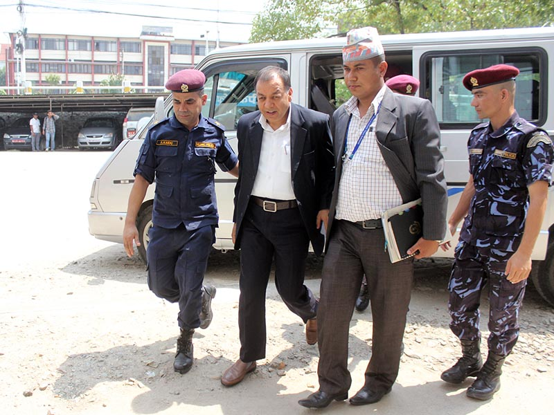 Suspended Director General of Inland Revenue Department Chudamani Sharma being taken to the Special Court by the Commission for the Investigation of Abuse of Authority on Sunday, June 4, 2017. Photo: RSS