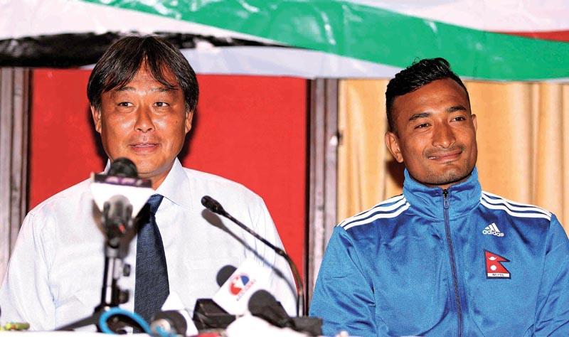 Nepali national football team head coach Gyotoku Koji speaks as skipper Biraj Maharjan looks on during a press meet in Lalitpur on Monday.