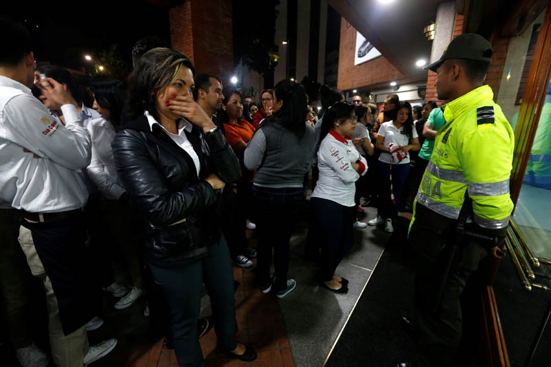 People stand outside the Andino shopping centre after an explosive device detonated in a restroom, in Bogota, Colombia, on June 17, 2017. Photo: Reuters
