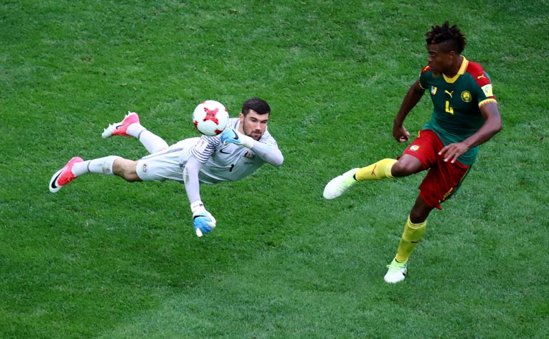 Australia's Mathew Ryan in action with Cameroon's Adolphe Teikeu in a  Group B match between Cameroon and Australia, in FIFA Confederations Cup Russia 2017, in Saint Petersburg Stadium, St. Petersburg, Russia, on June 22, 2017. Photo: Reuters