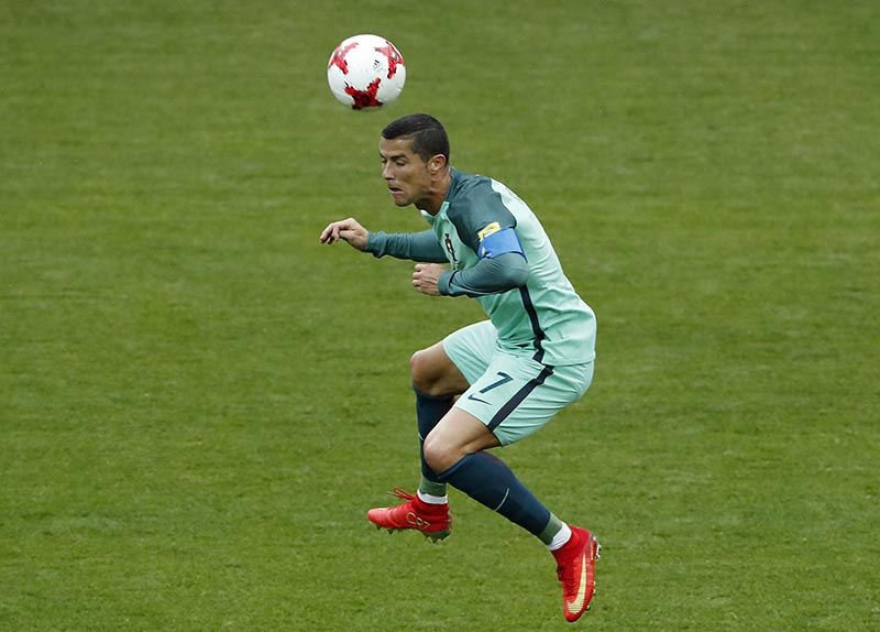 Portugal's Cristiano Ronaldo jumps for the ball during the Confederations Cup, Group A soccer match between Russia and Portugal, at the Spartak Stadium in Moscow, on Wednesday, June 21, 2017. Photo: AP