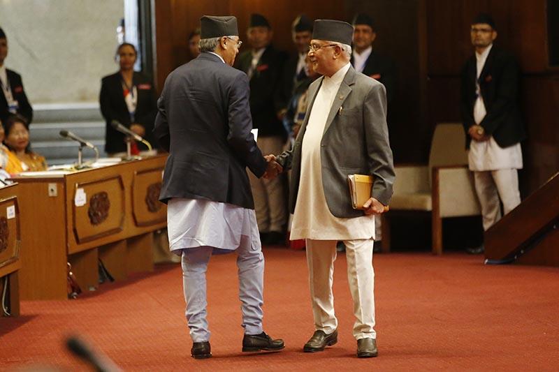 Newly elected Prime Minister Sher Bahadur Deuba shaking hands with CPN-UML Chair KP Sharma Oli, in the Parliament,  in Kathmandu, on Tuesday, June 6, 2017. Photo: Skanda Gautam/THT