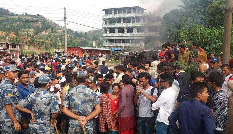 People gather around the accident site at Simle along Prithvi Highway in Dhading district, on Tuesday, June 6, 2017. Photo: Keshav Adhikari