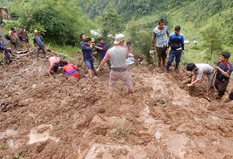 Locals along with security personnel searching for  missing people in a landslip that occurred in Lakuridanda of Bhimeshwor Municipality, Dolakha, on Wednesday, June 28, 2017. Photo: THT