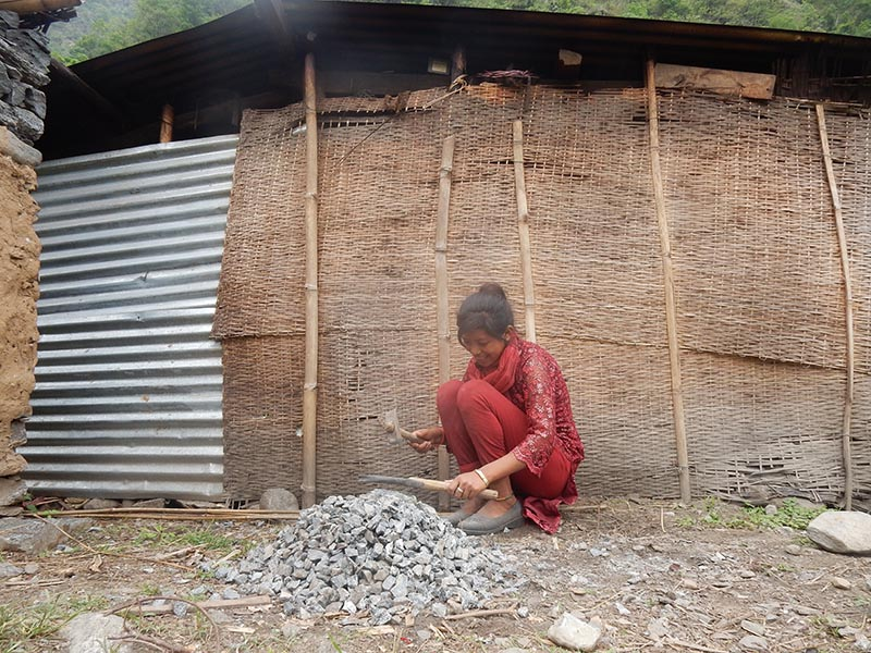 A girl breaking stones to pebbles in Dolakha district, on Wednesday, June 14, 2017. Photo: THT