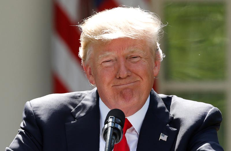 US President Donald Trump pauses as he announces his decision that the United States will withdraw from the landmark Paris Climate Agreement, in the Rose Garden of the White House in Washington, US, on June 1, 2017. Photo: Reuters