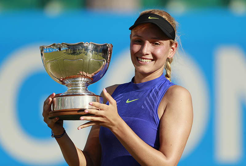 Croatia's Donna Vekic celebrates winning the final with the trophy. Photo: Reuters