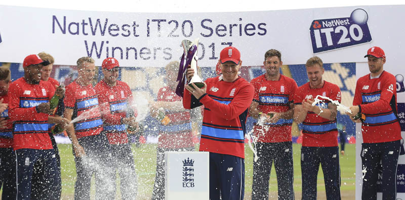 England's captain Eoin Morgan collects the trophy for the IT20 Series Winners 2017 after beating South Africa in Cardiff, Wales, Sunday June 25, 2017.  (Nigel French/PA via AP)