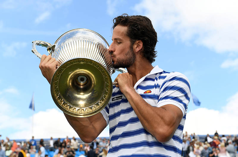 Spain's Feliciano Lopez celebrates by kissing the trophy after winning the final against Croatia's Marin Cilic. Photo: Reuters