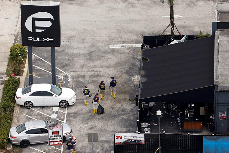 FILE PHOTO - Federal Bureau of Investigation (FBI) officials walk through the parking lot of the Pulse gay night club, the site of a mass shooting days earlier, in Orlando, Florida, US on June 15, 2016. Photo: Reuters