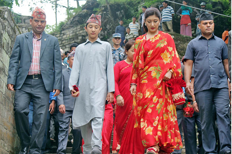 Former Princess Hemani Shah along with her son heads towards Gorkha Durbar to offer prayers to Gorakhkali temple in Gorkha, on Tuesday, June 6, 2017. Photo: RSS