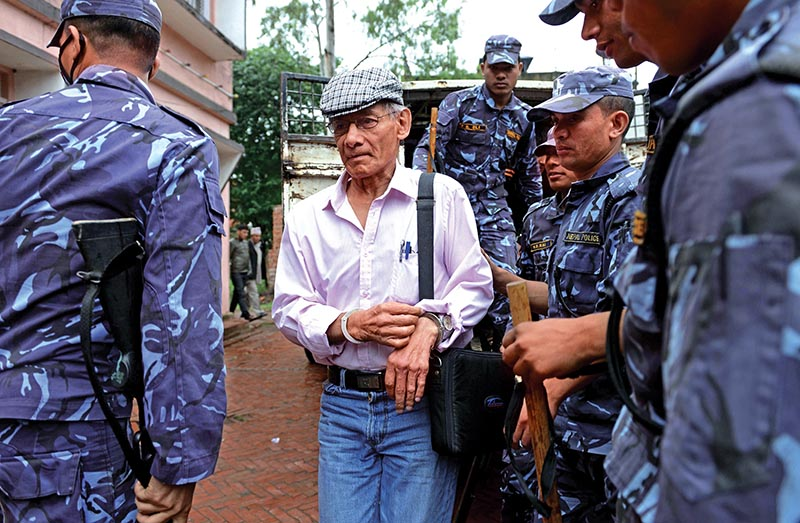 File - French serial killer Charles Sobhraj (centre) being brought to the district court for a hearing on a case related to murder of a Canadian backpacker, in Bhaktapur, on May 26, 2014. Photo: AFP