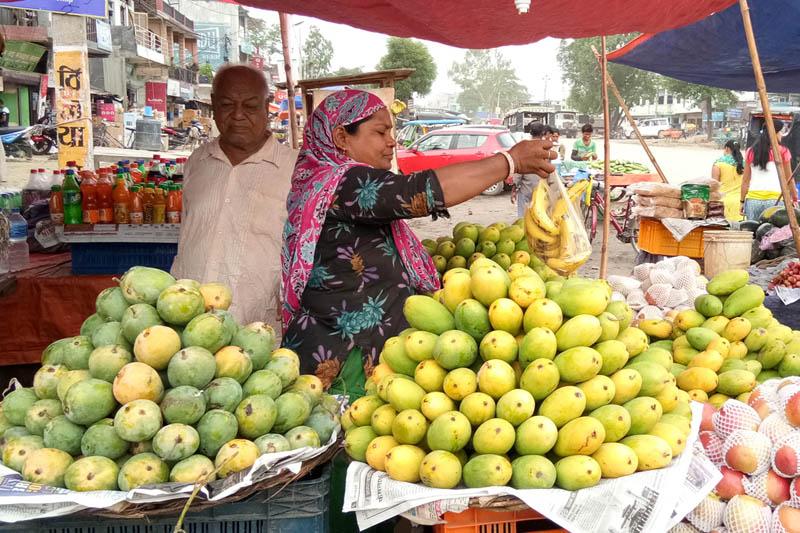A woman vendor awaits customers in Chanauta of Kapilvastu district, on Friday, June 9, 2017. Photo: RSS