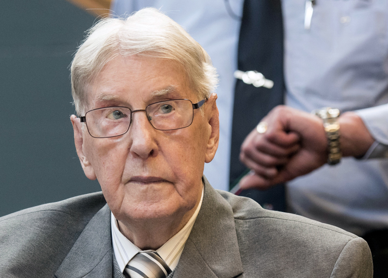 FILE-  In this June 17, 2016 file photo former SS sergeant Reinhold Hanning who served as a guard at Auschwitz sits in the courtroom in Detmold, Germany. Photo: AP