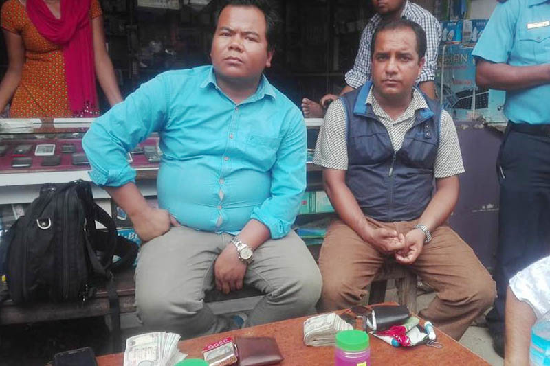 CIAA Office, Bardibas, apprehends the executive chiefs of Golanjor Rural Municipality and Fikal Rural Municipality Bhola Kumar Ale (left) and Satish Bhattarai respectively, with bribe in Sindhuli District, on Tuesday, June 6, 2017. Photo: Min Kumar Dahal