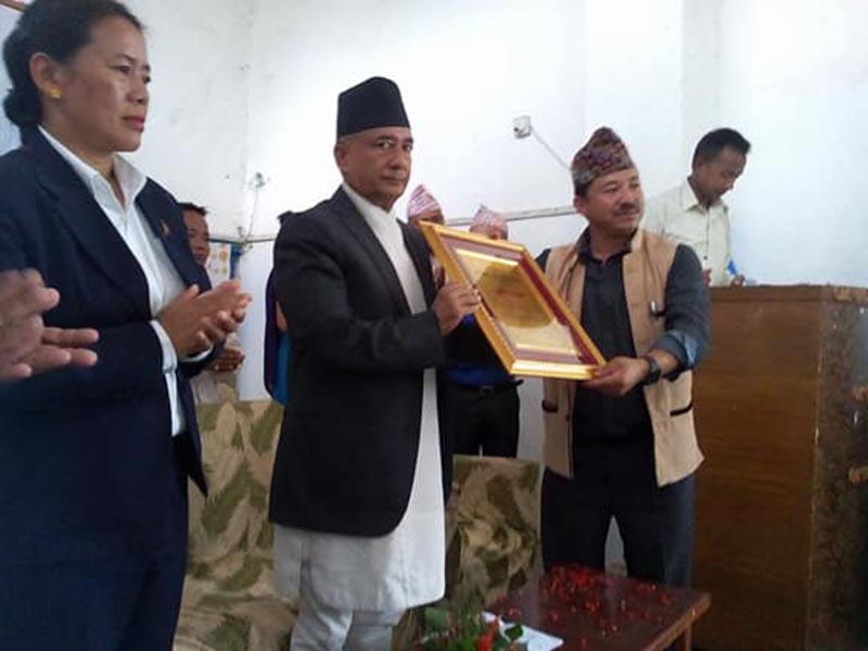 Finance Minister Gyanendra Bahadur Karki receiving an honour by Bhojpur Chamber of Commerce and Industry in Bhojpur on Sunday, June 25, 2017. Photo: Niroj Koirala