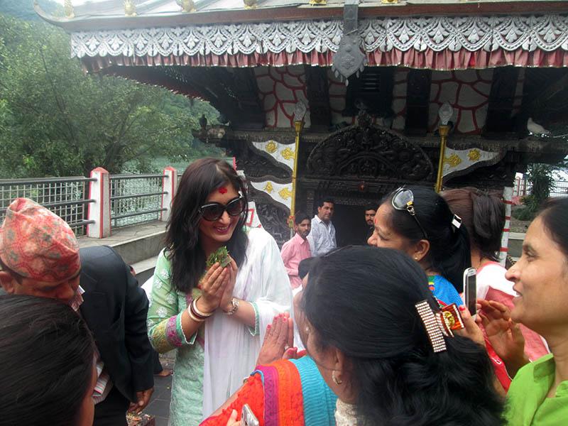 Locals greet former Princess Hemani Shah at the Tal Barahi Mandhir in the middle of Phewa Lake in Pokhara, on Thursday, June 15, 2017. Photo: Rishi Ram Baral