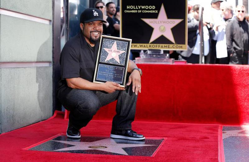 Rapper Ice Cube poses by his star after it was unveiled. Photo: Reuters