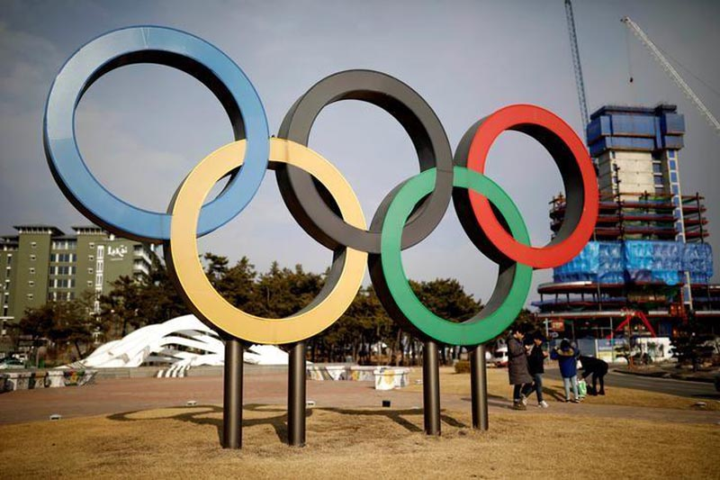 People walk past the Olympic rings in Gangneung, South Korea, on February 9, 2017. Photo: Reuters
