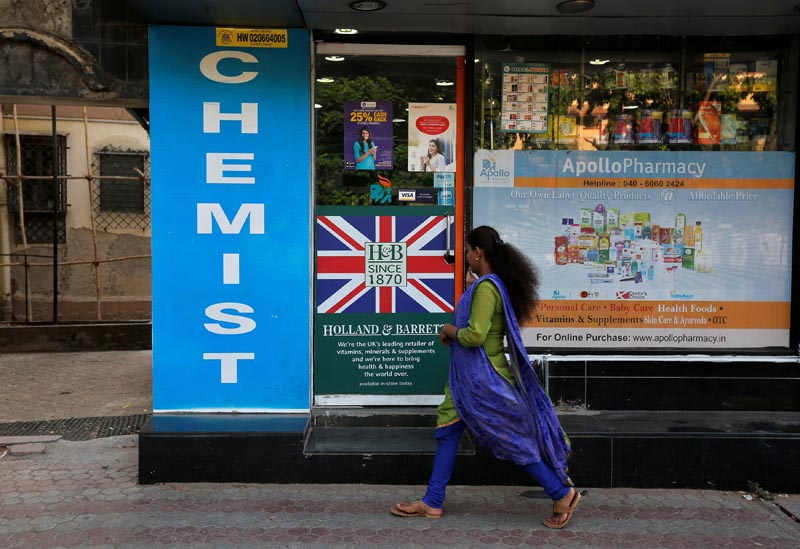 A woman walks past a chemist shop in Mumbai, India, on April 28, 2017. Photo: Reuters/ File