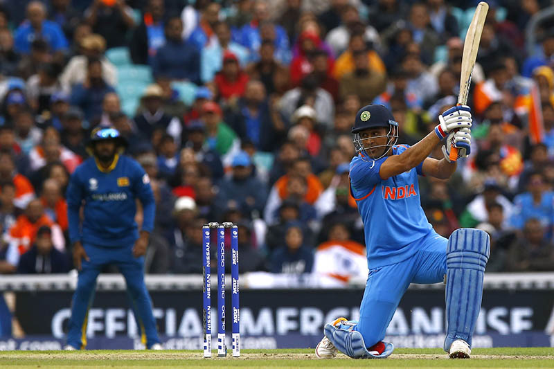 India's MS Dhoni plays a glorious square drive against Sri Lanka during Champions Trophy at the Oval, on Thursday, June 8, 2017. Photo: Reuters