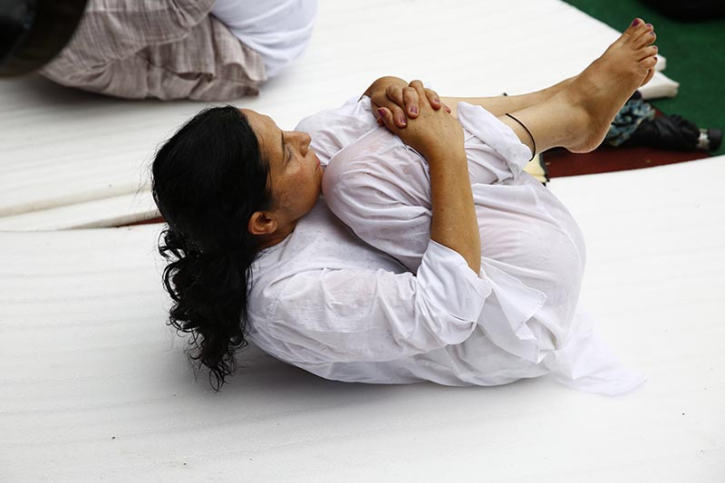 A Nepali woman practises Yoga to mark the International Yoga Day in Kathmandu, on Wednesday, June 21, 2017. 2017. Photo: Skanda gautam