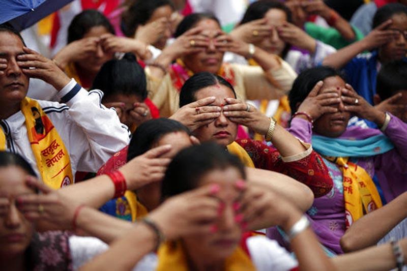 Nepali women perform Yoga during International Yoga day in Kathmandu, on Wednesday, June 21, 2017. Photo: AP