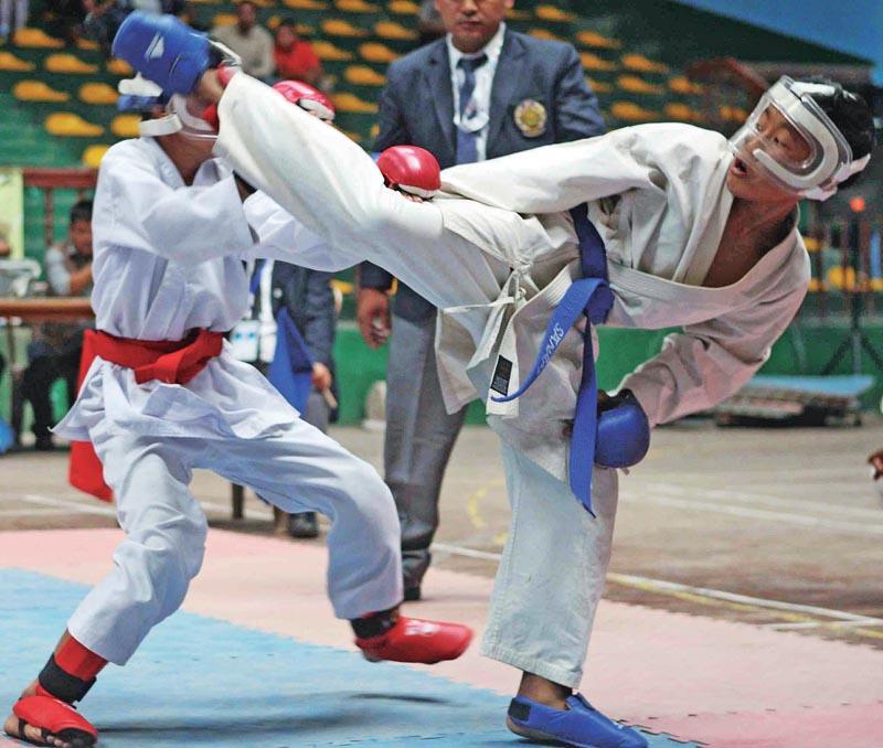 Jonam Limbu (right) fights against Arjun Lama during their boyu0092s 30kg bout of the IWF International Karate Championship in Kathmandu, on Saturday. Photo: THT