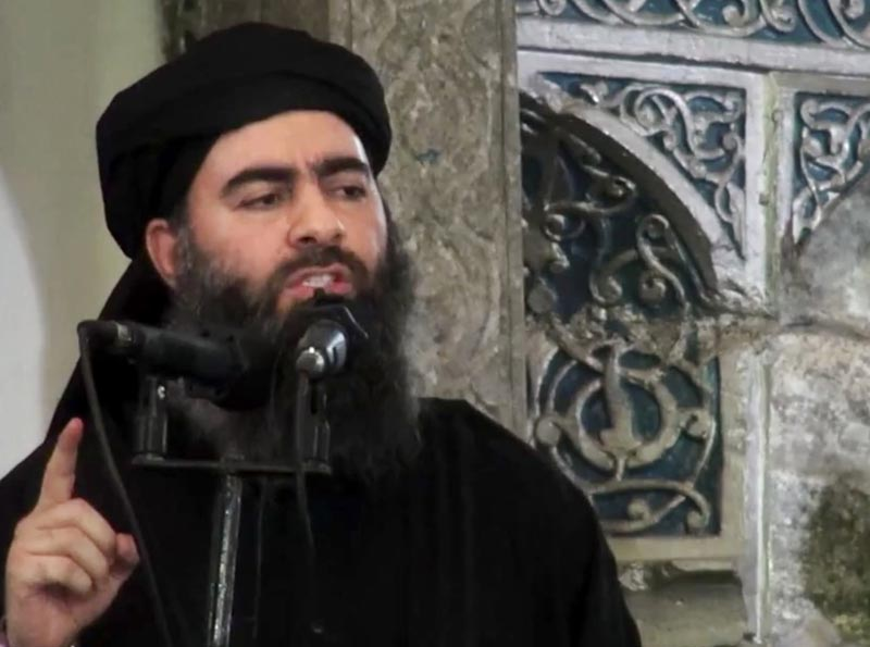 FILE - This file image made from video posted on a militant website, on Saturday, July 5, 2014, purports to show the leader of the Islamic State group, Abu Bakr al-Baghdadi, delivering a sermon at a mosque in Iraq during his first public appearance. Photo: AP
