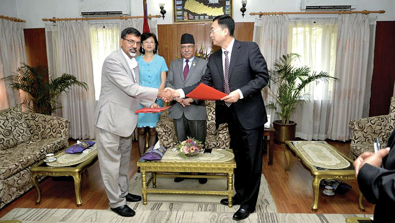 Energy Minister Janardan Sharma and Lv Zexiang, president of CGGC Beijing, exchanging the MoU that was signed to develop Budhigandaki Hydropower Project, in Kathmandu, on Sunday, June 04, 2017. Photo: THT