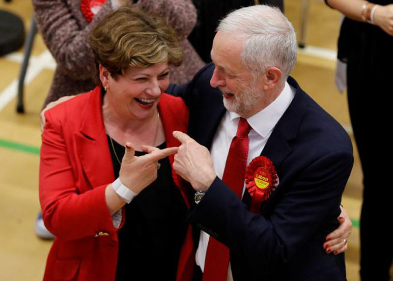 Jeremy Corbyn, leader of Britain's opposition Labour Party, and Labour Party candidate Emily Thornberry gesture at a counting centre for Britain's general election in London, on June 9, 2017. Photo: Reuters