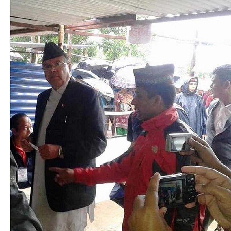 CPN-UML leader Jhala Nath Khanal at National Pre-primary school-based polling centre in Ilam to cast his vote in the second round of local level elections on June 28, 2017. Photo: RSS