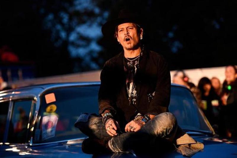 Actor Johnny Depp poses on a Cadillac before presenting his film The Libertine, at Cinemageddon at Worthy Farm in Somerset during the Glastonbury Festival in Britain, on June 22, 2017. Photo: Reuters