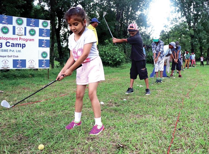 Yashaswi Bhandari plays a shot during the launching event of the CMS Junior Golf Development Programme at the Royal Nepal Golf Club in Kathmandu, on Saturday. Photo: THT