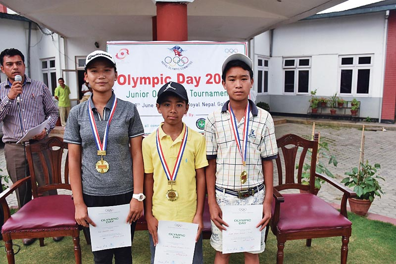 (From left) Kasmira Shah, Sadbhav Acharya and Binod Tamang with the gold medals after the Olympic Day Junior Golf Tournament at the RNGC in Kathmandu, on Sunday. Photo: THT