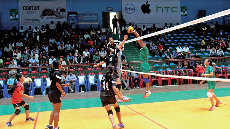 Players of Western Region Volleyball Association and New Diamond Academy (right) in action during the KNP National Womenu0092s Volleyball Championship in Kathmandu, on Thursday. Photo: THT