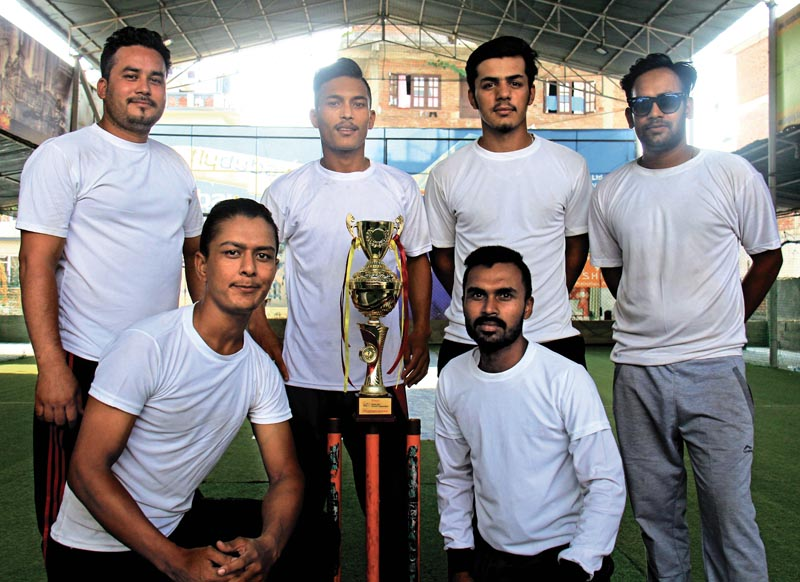 Players of Kaustuv College pose with the AEC Super Cup Cricket trophy at the Ultimate Indoors in Kathmandu, on Friday. Photo: THT