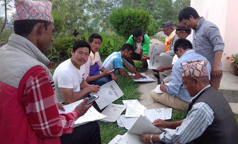 Cadres of Nepali Congress going through the rosters of the candidates who filed their nominations for the June 28 local polls in Khotang district on June 18, 2017. Photo: RSS