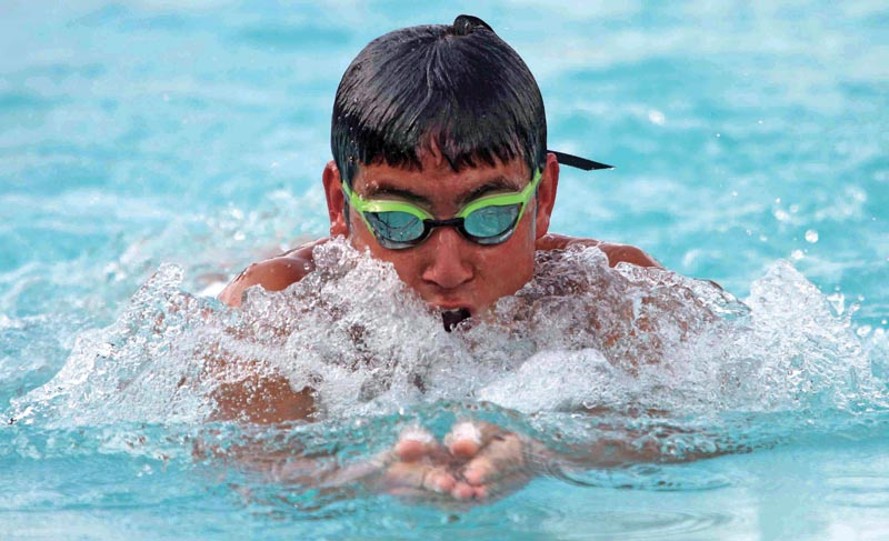 Kiran Karki swims during the 50m breaststroke event of the Age-group and Open nSwimming Championship at the International Sports Complex in Lalitpur, on Friday.  Photo: Udipt Singh Chhetry/ THT