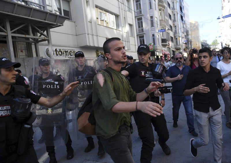 Riot police move to detain a person as they stop protesters for lesbian, gay, bisexual, trans and intersex rights from gathering in large numbers for LGBT Pride protest following a ban issued by the governor, in Istanbul, Sunday, June 25, 2017. Photo: AP