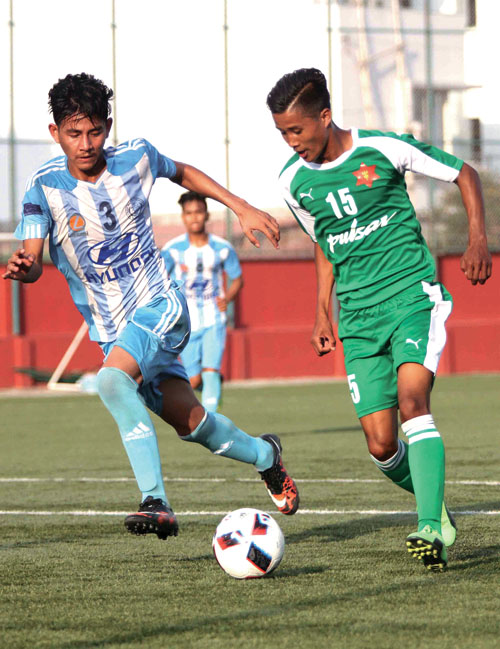 Players of TAC and Manang Marshyangdi Club in action during their Lalit Memorial U-18 Football Tournament match in Lalitpur on Wednesday, May 31, 2017. Photo: THT