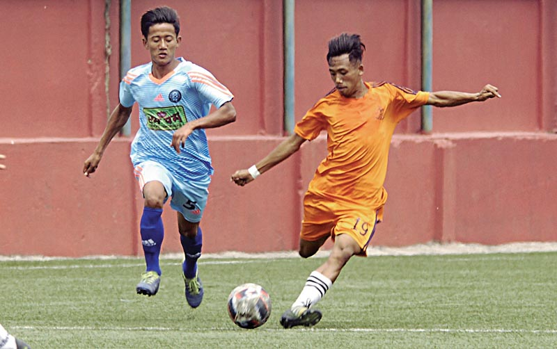 Tshring Sherpa (right) of APF and Dojanhang Lingden of Jhapa-XI vie for the ball during their Lalit Memorial U-18 Football Tournament match in Lalitpur, on Sunday. Photo: Naresh Shrestha/ THT