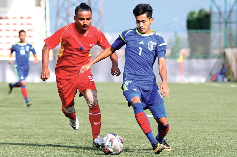 Aakash Shrestha (left) of Friends Club and Kamal Deuba of Far-western FC vie for the ball during their Lalit Memorial U-18 Football Tournament match at the ANFA Complex in Lalitpur on Friday. Photo: THT