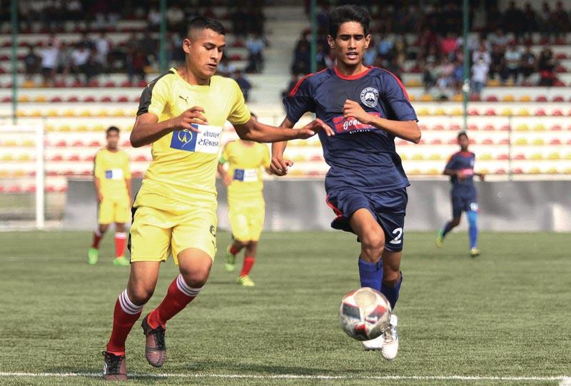 Laxman Pariyar (left) of NPC and Bijay nKumar Pokharel of Morang FC vie for the ball during their Lalit Memorial U-18 nFootball Tournament match in Lalitpur non Saturday. Photo: THT