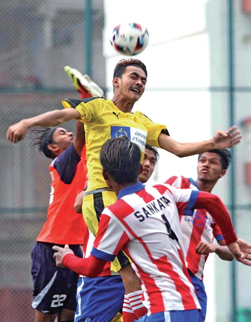 Players of CMG Club Sankata and NPC (top) in action during their Lalit Memorial U-18 Football Tournament match in Lalitpur on Monday. Photo: THT