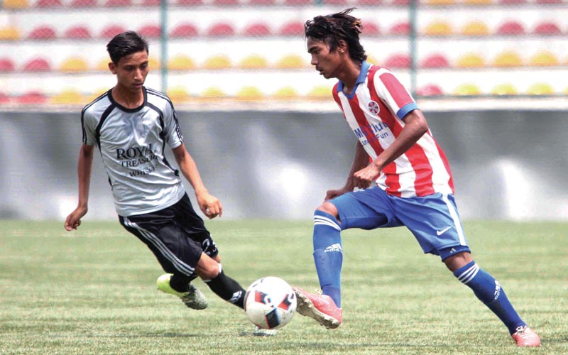Players of Jawalakhel Youth Club and Sankata Club (right) vie for the ball during their Lalit nMemorial U-18 Football Tournament match in Lalitpur on Friday. Photo: Uditp Singh Chhetry/ THT