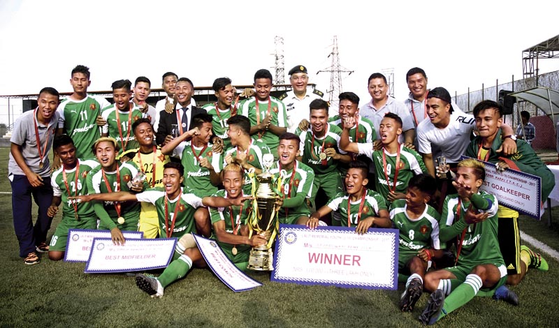 TAC players and officials celebrate after winning the Lalit Memorial U-18  Football Tournament in Lalitpur, on Monday. Photo: Naresh Shrestha/ THT
