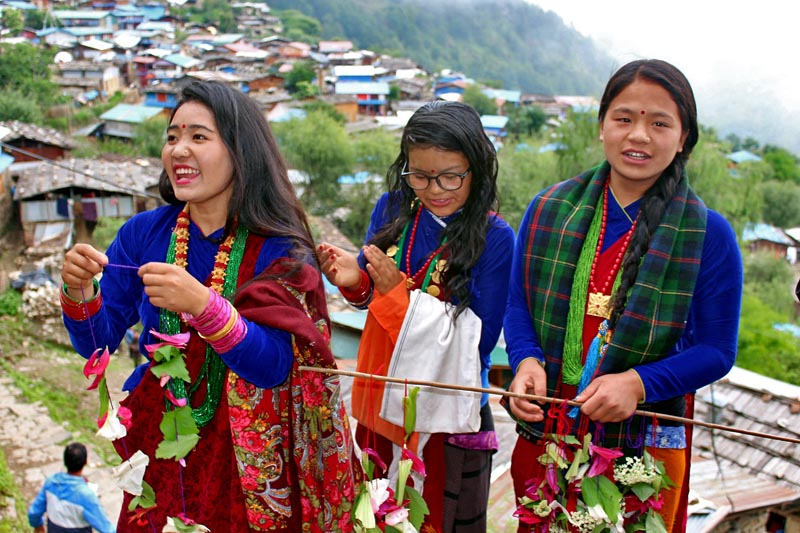 Girls clad in traditional attire are seen welcoming guest to the village in Laprak of Dharche Rural Municipality in Gorkha district, on Saturday, June 24, 2017. Photo: RSS