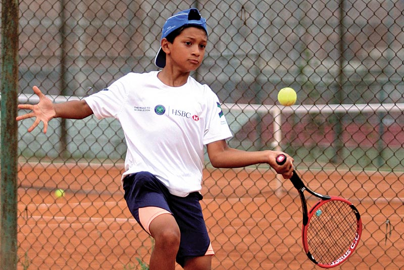 Aarav Hada returns to Shiren Maharjan during the Nepal Junior Open Lawn Tennis Championship in Lalitpur, on Tuesday. Photo: THT