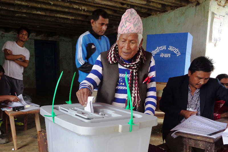 An elderly casts vote at a polling centre during the second round of local level election in Ilam district, on Wednesday, June 28, 2017. Photo: RSS